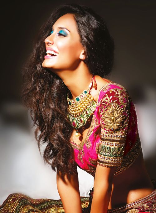 Beautiful desi bridal outfit, jewelry, and makeup.