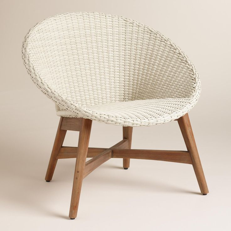 Bring a casual, mid-century vibe to your outdoor area with our cozy chair featuring an antique white all-weather wicker seat and teak wood legs for intriguing contrast. www.worldmarket.com #WorldMarket Outdoor Entertaining
