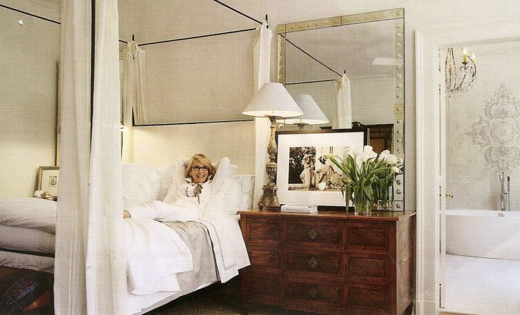 Tara Shaw's Bedroom.  Love the scale of large black and white photograph on chest of drawers, White walls give pieces importance.