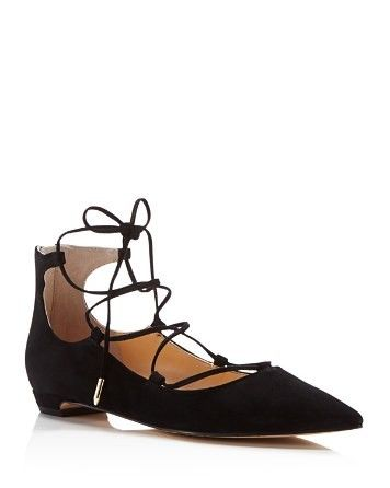 Give your ballet flats a day off with this sultry suede lace up pair by Ivanka  Trump designed with the ease of a sleek back zip.