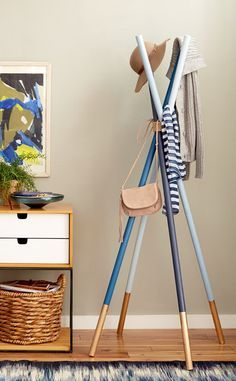 Want to Hang Even More Things?: This cute coat rack from Emily Henderson is made with inexpensive supplies and requires zero tool time. Grab some big dowels, rope, and your favorite shades of paint. If the reason you're sans clothes closet is because you're tight on space, this collapsible rack can be stored out of sight when you need even more square footage.