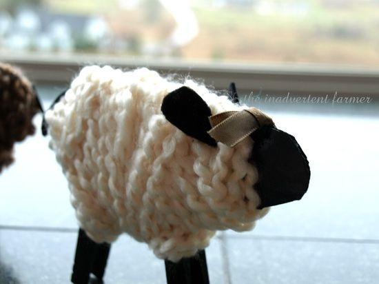 Yarn sheep - cardboard, wooden pegs, paint and yarn.  Follow the link as they've done loads of different cute colours