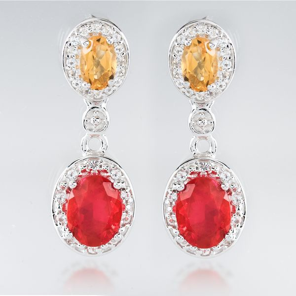 Like a vibrant flower or volcano, we love the fiery glow of these opal and citrine earrings. They're prefect for an island getaway! || 1.36ctw Oval Ethiopian Opal, .77ctw Citrine with .45ctw White Topaz Silver Earrings [Promotional Pin]