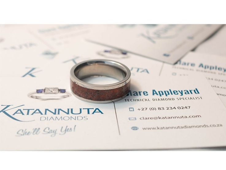 Our unique Njenjere titanium ring range is guaranteed to turn heads wherever this jewellery is worn. Simple yet striking, this 8mm wide flat titanium ring contains a 4mm wide crushed gemstone inlay. Manufactured to order, this ring is available up to size Z +6 and is priced from R1,900, depending on ring size. Featuring crushed gemstones of your choice, the gem inlay can feature one colour gemstones, or a coloured mixture of gemstones.