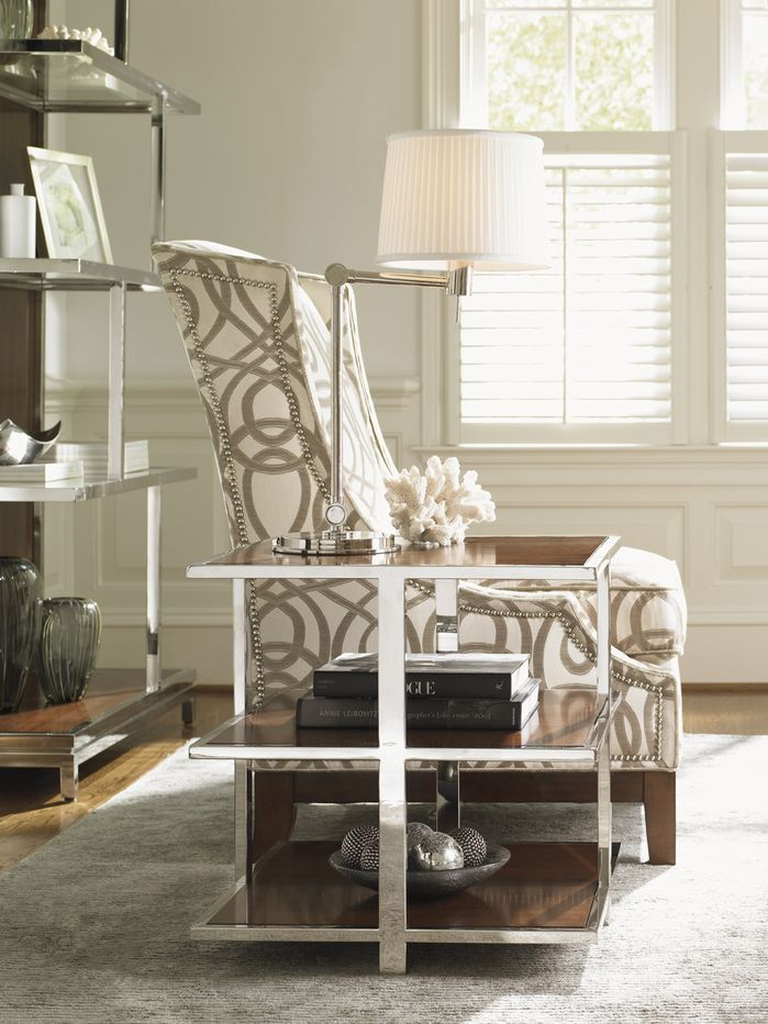 A Patterned Nailhead Accent Chair Paired With Wood Chrome End Table Perfection