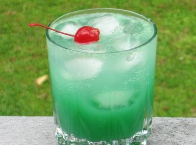 Blue Screw (1 oz. Vodka 1 oz. Blue Curacao 4 oz. Orange Juice 2 oz. Sprite Cherry for garnish)