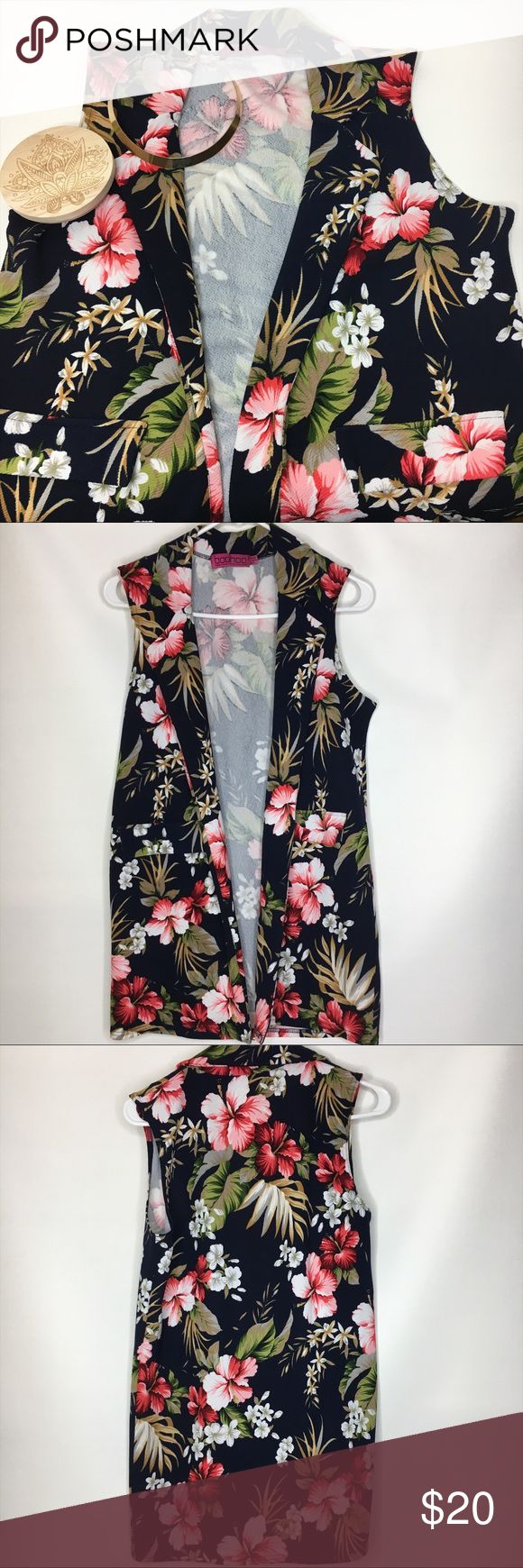 Tropical sleeveless duster coat Boohoo tropical sleeveless duster coat. Can easily dress up any outfit but can also give out casual but chic vibes. Two front faux pockets. Size 6 but the material is very stretchy so can fit many sizes! In excellent, like new condition. Boohoo Jackets & Coats