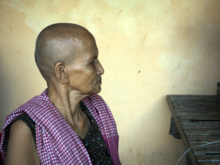 Chief weaver, 71 year old Mrs. Hem Vorn in her village 50km outside of Phnom Penh. Handmade change. Fair Trade.