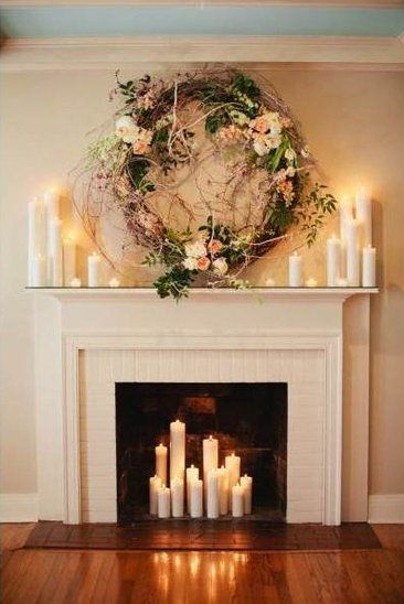 Gorgeous Ceremony Backdrop: Fireplace decorated with romantic candles and a beautiful wreath. #wedding #decor #rockmywinterwedding @Rock My Wedding