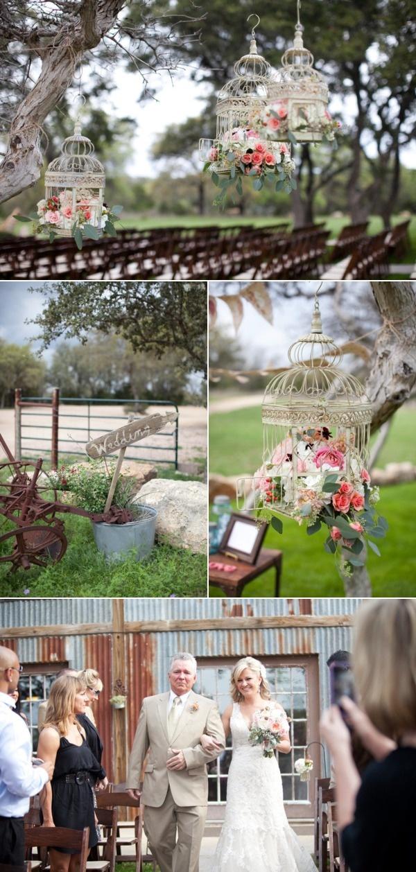 garden party wedding - flowers hanging in birdcages - so sweet