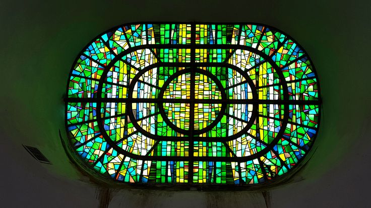 A view of the green stained glass windows inside of the Makedonium monument..