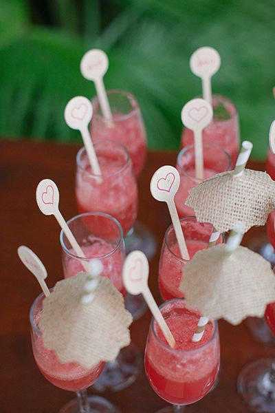 Don't leave your cocktails as is — they're always more fun when dressed up. Add burlap umbrellas and heart-stamped stirrers for a punch of whimsy.Related: Signature Cocktails for Summer Weddings