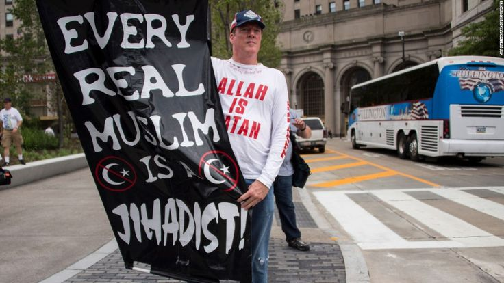 A Donald Trump supporter holds up an anti-Muslim poster near the Republican National Convention in Cleveland in July.