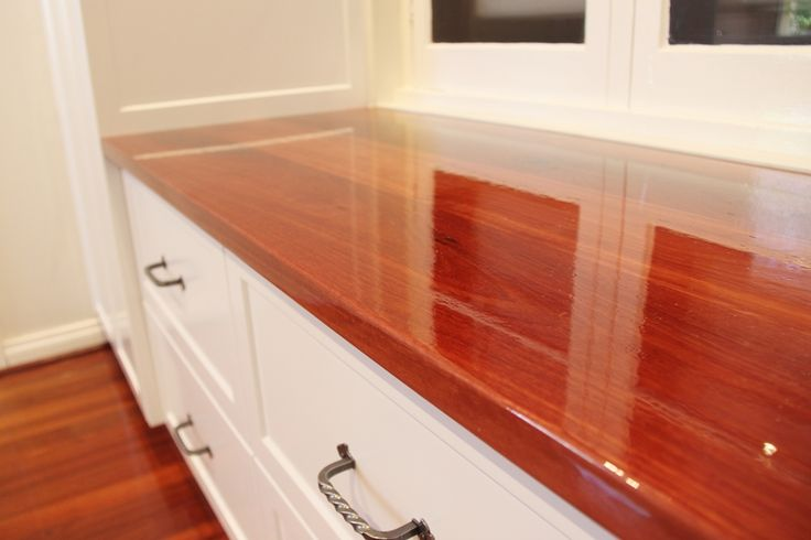 Custom storage with jarrah top and painted doors in satin finish