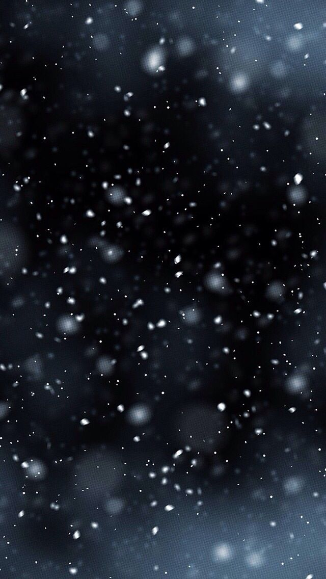Snow falling at night. Peaceful and quiet