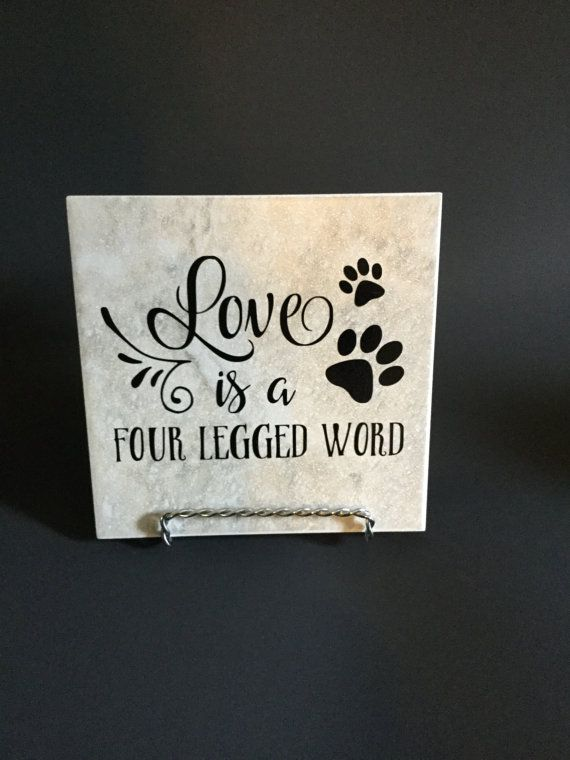 Our Pet Quote Decorative Ceramic Tile plaque has the quote Love is a Four Legged Word. Perfect pet art for the dog or cat lover. Each 6 ceramic tile measures 5 3/4 x 5 3/4 (although it is classified as a 6x6) and comes with an easel display stand.  Also available is a 12x12 square ceramic tile. Decorative Tile with vinyl saying matches perfectly with any decor. I use high quality self-adhesive permanent vinyl for the quote. Easel stand IS included Ceramic Tile color may vary slightly. Check…