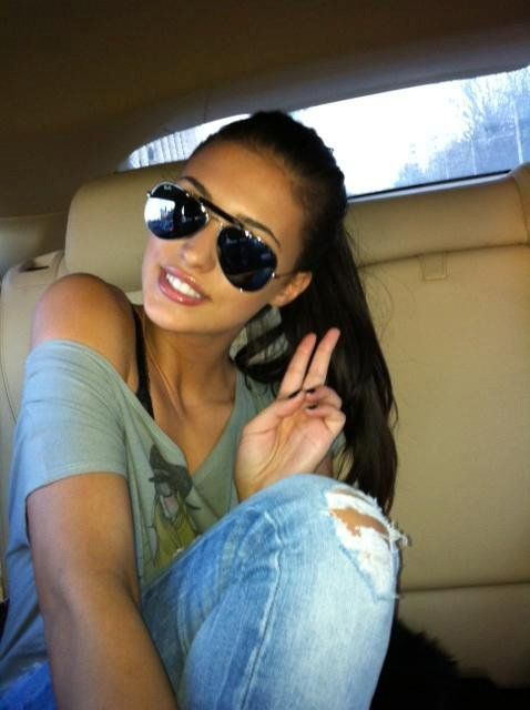 girl in car # aviator sunnies # pony tales# off should t with ripped jeans GG's tiny times