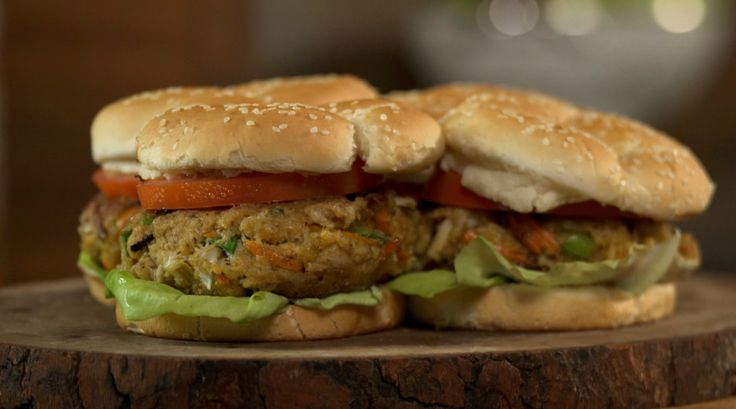 Hearty Crab Cake Sandwich Recipe with video instructions: Easy to make and super delicious crabcake sandwiches.  Ingredients: 1 pound backfin crab meat, 2c bread crumbs, 3T old Bay, 2 eggs, ¼ c mayo, ½ c small diced carrots, ½ c small diced celery, ¼ c green onion, Butter for cooking, Sesame seed bun, bib lettuce, sliced tomato