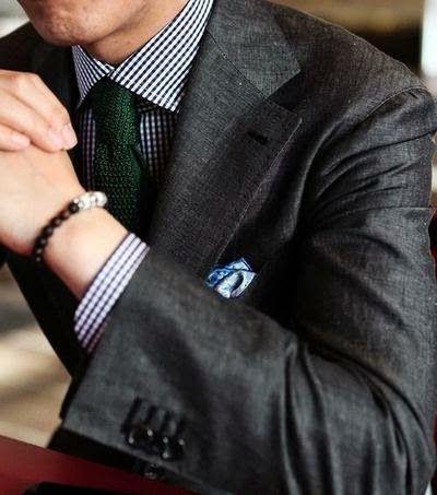 Dark grey jacket, navy gingham shirt, green knit tie