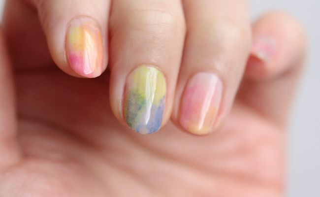 Jelly Watercolour Nails: 1) Apply base coat. 2) Apply two coats of base color 3) When the polish is dry, apply the polishes on each finger with sponge to make watercolour effect.