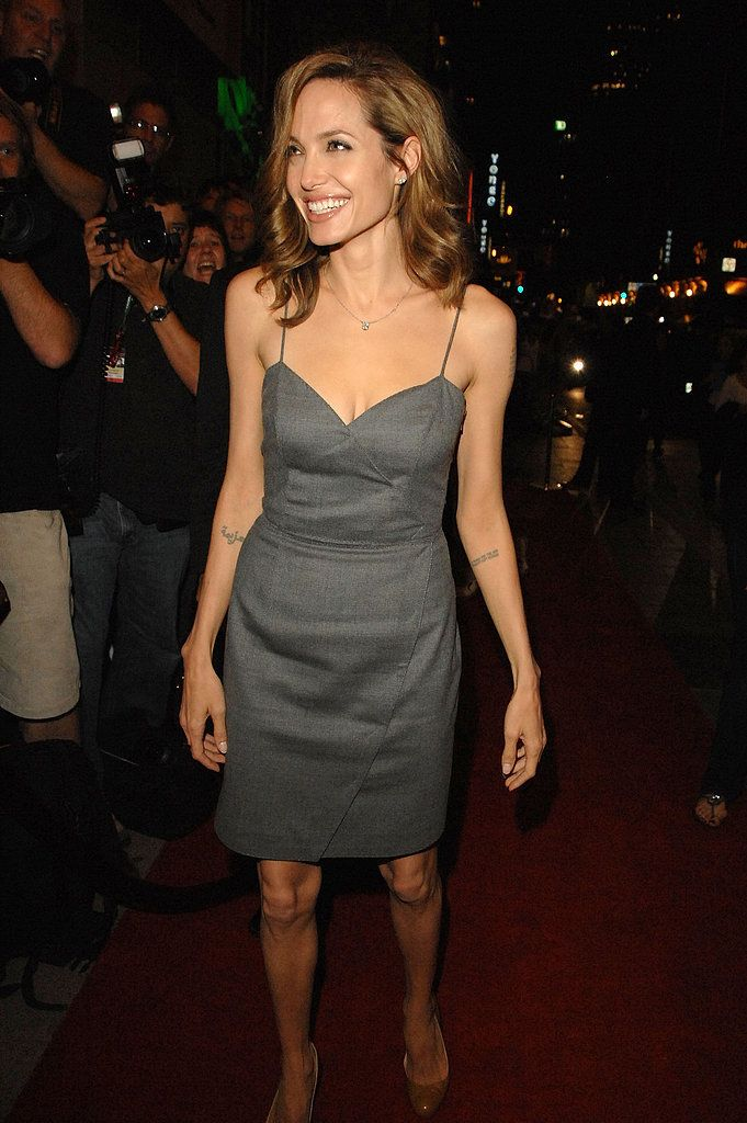 For a September 2007 premiere of The Assassination of Jesse James by the Coward Robert Ford in Toronto, Angelina Jolie picked a gray dress.