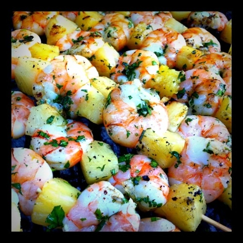 BBQ    Bamboo skewers    2 pounds raw shrimp (peeled, with tails cut)    1 can of pineapple chunks in juice (drained with juice saved)    1 bunch of cilantro (chopped)    1 Lemon (juice only)    3 cloves of garlic (minced)    3 Tablespoons olive oil    1/2 cup of ice    Salt and Pepper to taste    What to do:    1. Place the cilantro, lemon juice, 1/2 can of pineapple juice, garlic and olive oil in a large bowl.    2. Add shrimp to the cilantro mixture, add ice cubes and refrigerate for…
