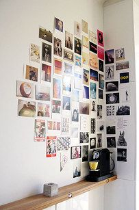 Display postcards a polaroids from your travels for a unique accent wall.