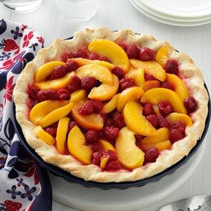Summer in a piecrust -- juicy peaches and brilliant raspberries. 5-star recipe at Taste of Home.