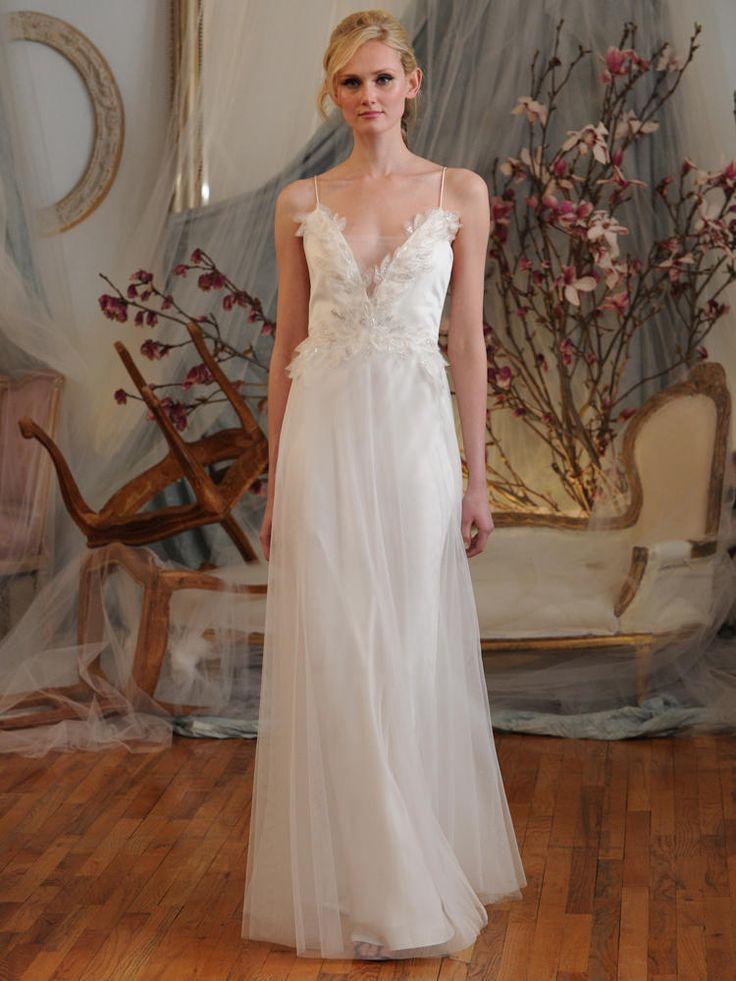 Elizabeth Fillmore tulle wedding dress with plunge neck line, bodice adorned with feathered organza Spring 2016
