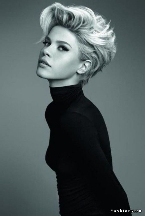short - - volume in front. classy looking gal, beautiful contouring love the turtle neck too
