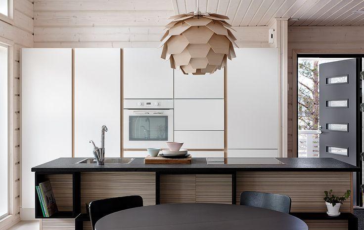 Tulikiven Nero Assoluto -graniittitasot keittiössä. Villa Aava, kohde 22. http://www.tulikivi.fi/tuotteet/TK-427_Nero_Assoluto