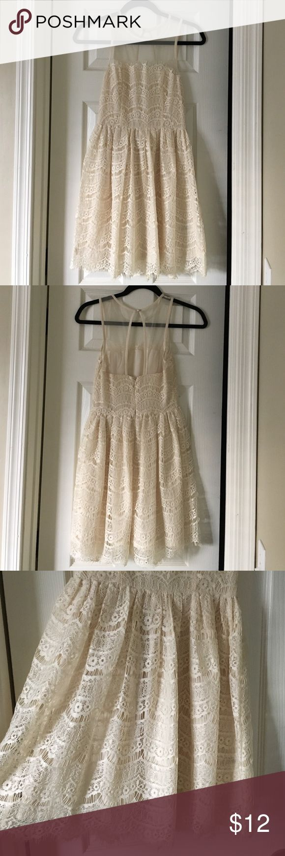 En Créme cream lace top dress. NW with partial tag Cream lace dress with sheer top and cut out back with pearl button. Never worn. NW & extra button. It has lovely lace details! Perfect for a bridal shower or bachelorette party. En Créme Dresses Mini
