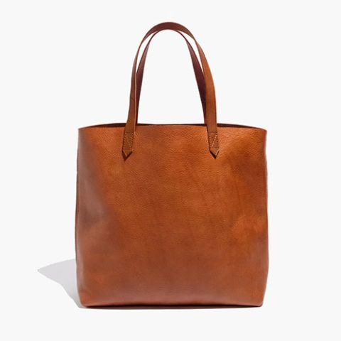 10 Fun Tote Bags We Love - Cute and Colorful Totes for Women - Madewell Transport Tote - $168, madewell.com. The Transport tote is a popular choice for its polished, clean silhouette. Add another neutral to your collection with the English saddle shade. This bag is just the right size for everyday use, and has a zip pocket near the top, so you won't have dig for your keys. Find more statement accessories worth Pinning at redbookmag.com.