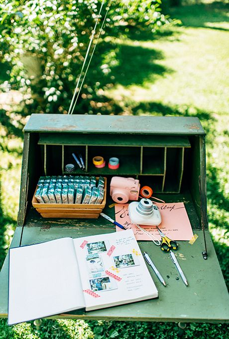 Create a photo station with polaroid cameras, extra film, pens, and washi tape so guests can snap a picture and leave a note | Brides.com