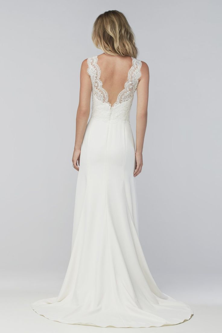 Wtoo Style: Thandie Old World romance meets modern simplicity. For the contemporary bride who wants a streamlined, sexy shape, this stretch satin-lined gown starts with a fitted sweetheart neckline and a defined waist before falling into a soft, flooring-dusting skirt with a sweep train. And for the traditional bride, Cybele lace overlays on the bodice, straps, and back adds a feminine touch. This ivory georgette wedding dress gives you the best of both worlds.