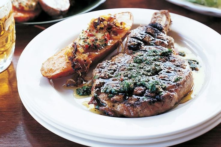 A sumptuous steak served with Chimichurri, a popular sauce for grilled meats in Argentina.