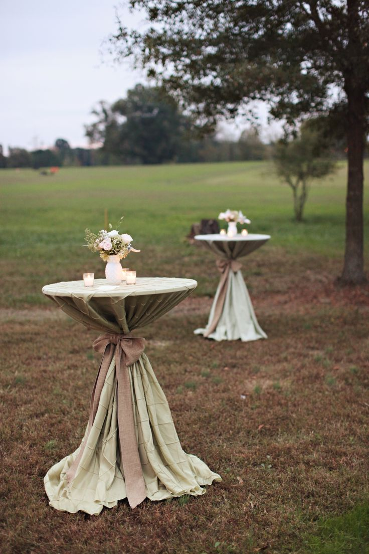 Sage pintuck linens with burlap sashes on the cocktail ...
