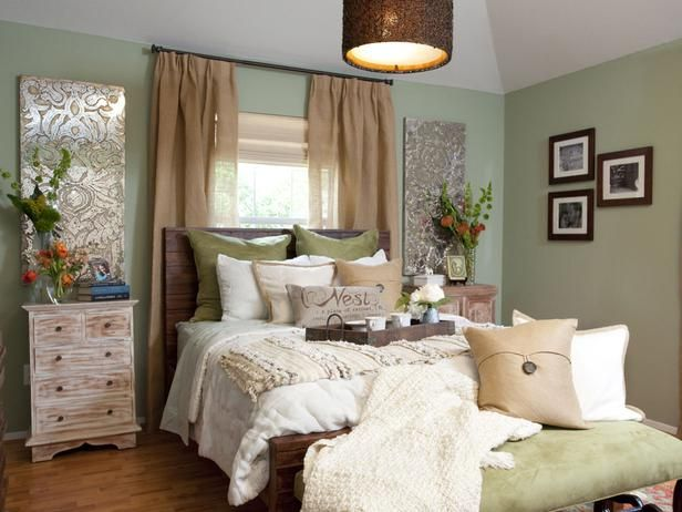 Property Brothers bedroom renovation.  Love the homey feel of the room.  The earthy green on the walls and the kiwi green suede on the bench are a nice touch.  A few shimmery art pieces add a little sparkle around the room to offset the earthy, natural feel of the other pieces.