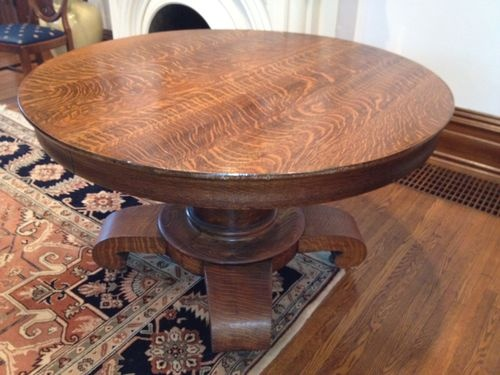 "Antique quarter-sawn tiger oak library table with leaf, priced at 585 USD.  Measures 48"" diameter without leaf, 31"" high."