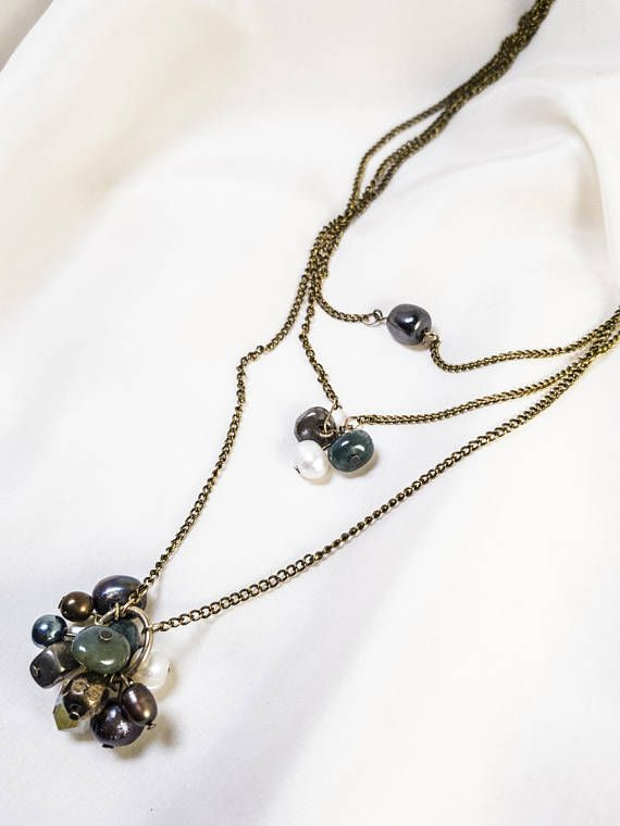 Pearls and gemstones delicate triple strand brass necklace.