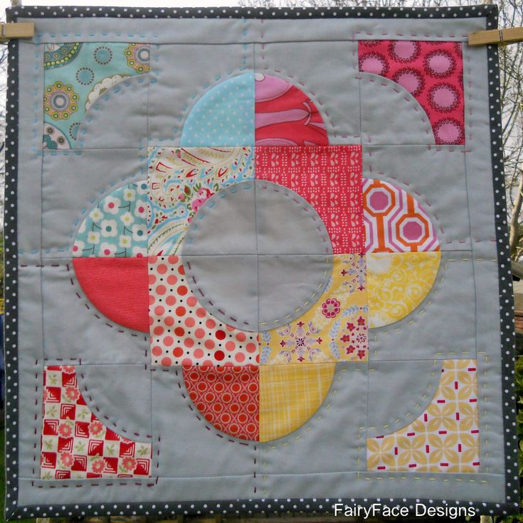 love this design using drunkard's path block and big stitches