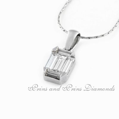 """There are 5 = 0.43ct HI/SI baguette cut diamonds """"hidden""""  set in an 18k white gold 4 claw pendant"""