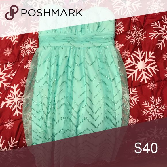 Mint green formal homecoming dress It's a strapless mint green sparkly dress Dresses Strapless
