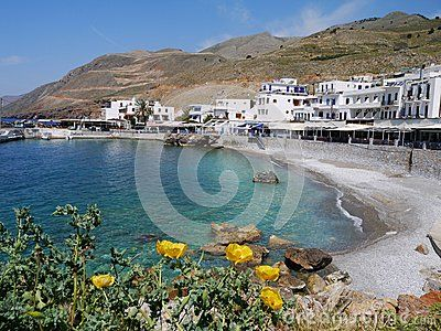 Blue bay of Chora Sfakion with spring flowers,Crete,Greece