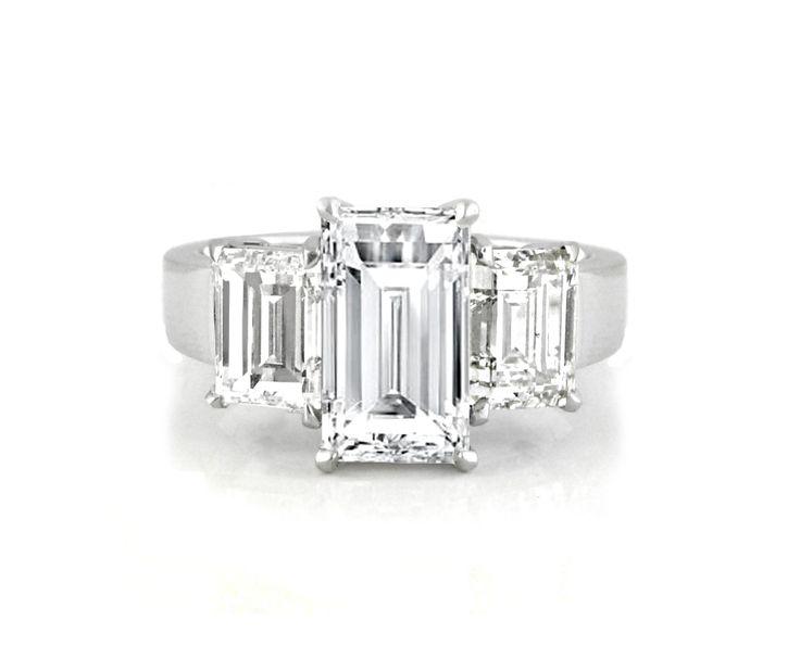 A Platinum and Baguette Cut Diamond Trilogy Ring