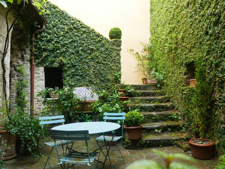 Charming courtyard with stone stairs leading to the first floor.