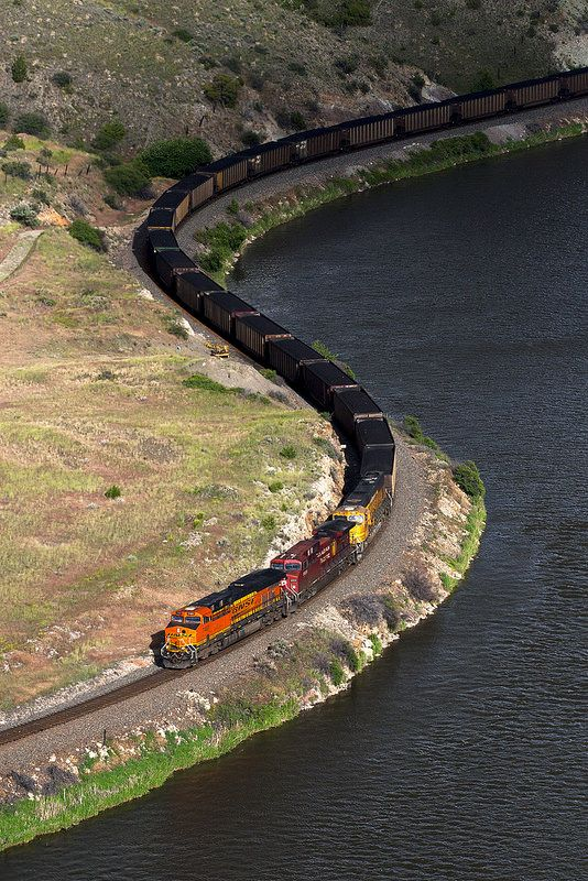 Yin n Yang - BNSF Railway ES44DC No. 7491 and Co. power a loaded coal train through the heart of Montana's very striking Lombard Canyon. The muddy Missouri River flows on...