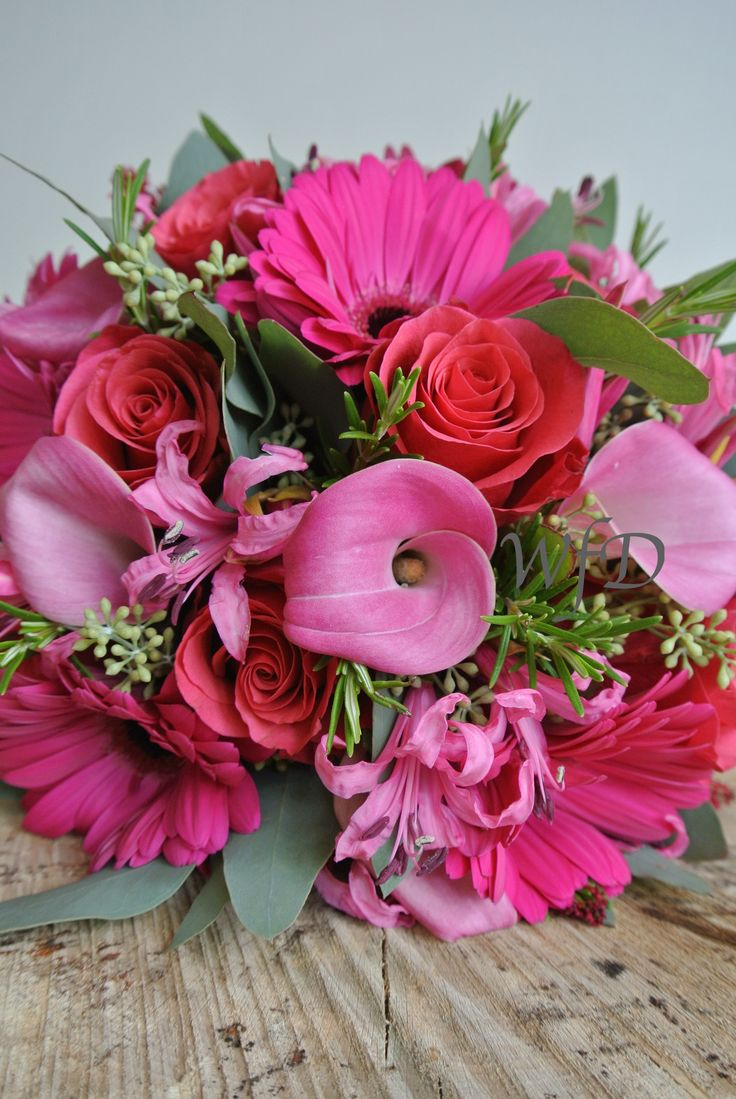 Cerise pink Gerbera, Calla Lily, Nerine and Rose brides bouquet.