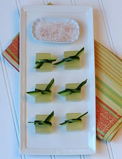 Cucumber-Lime Margarita Jelly Shot, tied up with cucumber ribbons.  Cayenne Sprinkle on the side