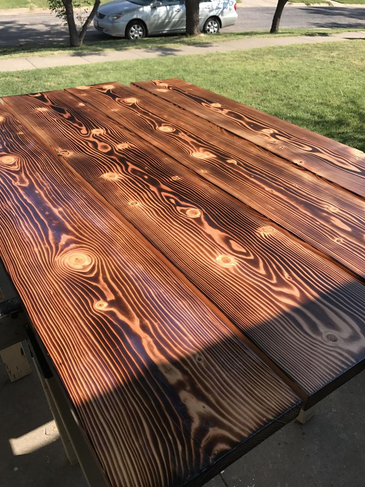 I did the burned wood finish for a table top... huge fan